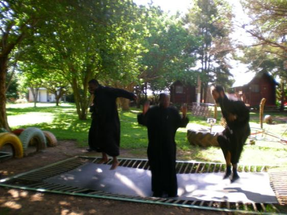 Coptic Priests in Africa spending some of their free time jumping on a trampoline.